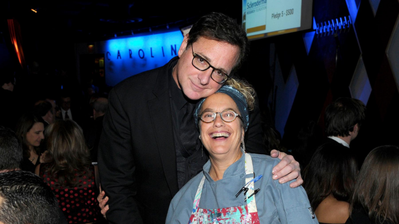 Cool Comedy   Scleroderma News   Comedian Bob Saget and restaurateur Susan Feniger smile for a photograph