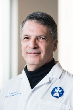 scleroderma and dental health | Scleroderma News | Professional headshot of Dr. David Leader, who is smiling and wearing his white coat.
